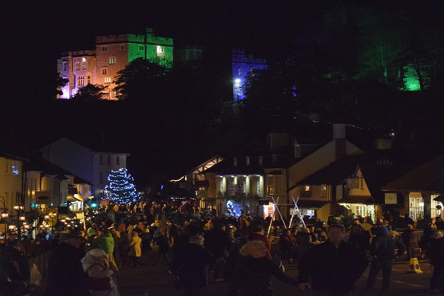 Dunster illuminated by glowing lights