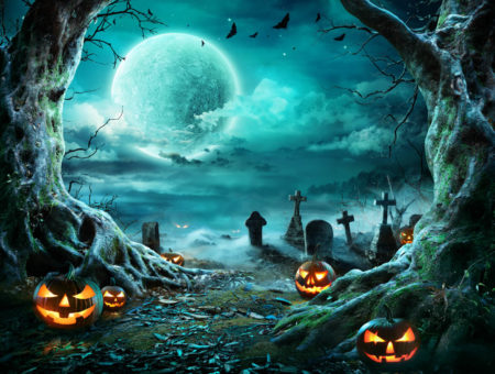 Jack O'Lanterns in cemetery with spooky full moon