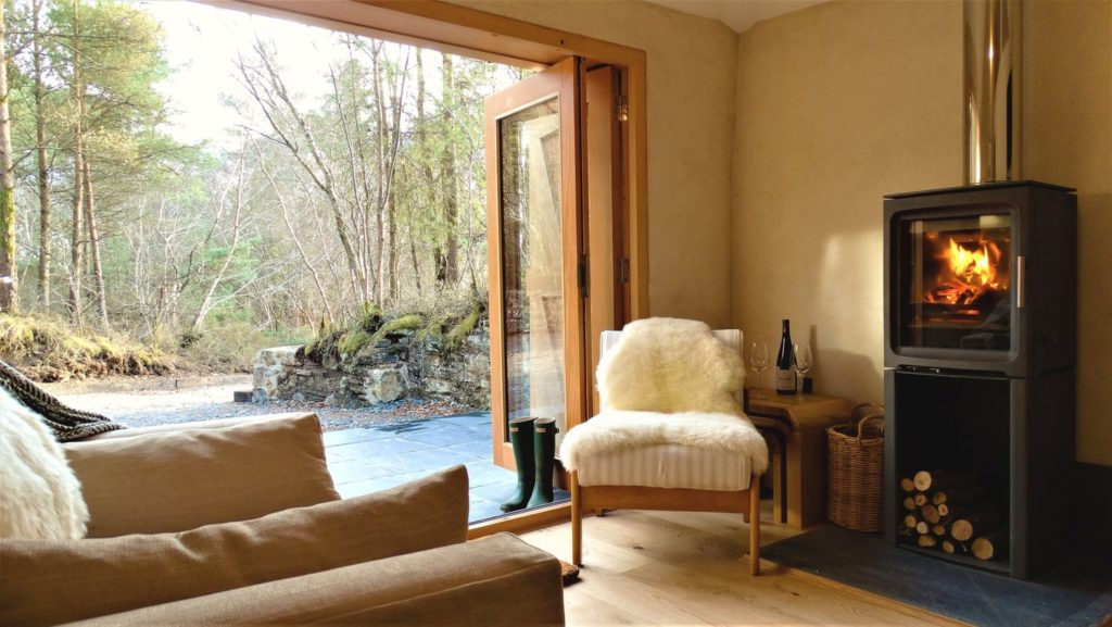 Romantic Lounge Area with Log Fire Burning. Rock View Cottage