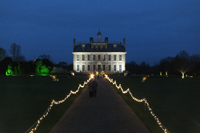View up to Kingston Lacy with path lined with lights