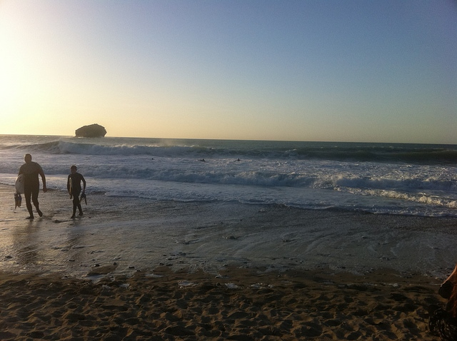 Surfers on Portreath Beach