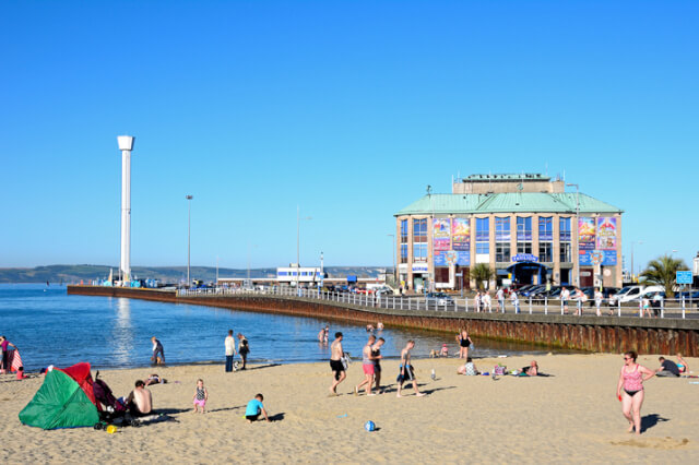 Weymouth Pavilion with a view of the beach, sea and pier.