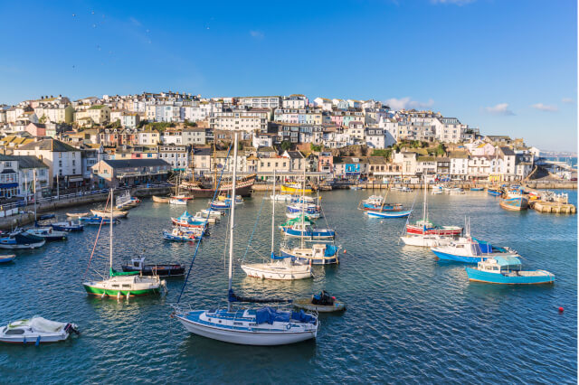 Brixham Harbour with town of Brixham in the background