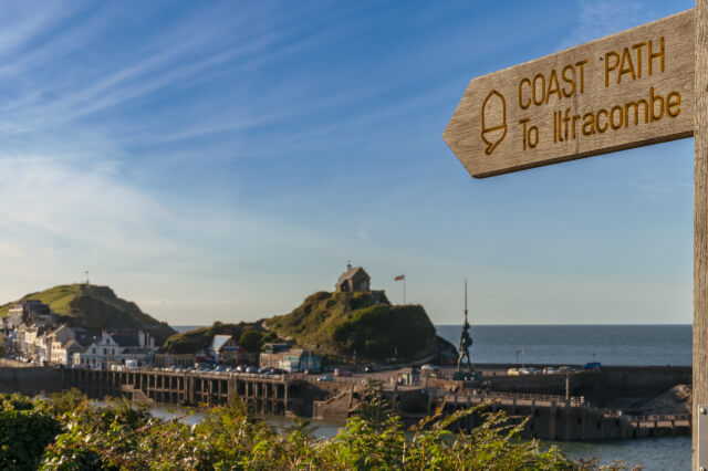 View of Ilfracombe, North Devon from the South West Coast Path with sign