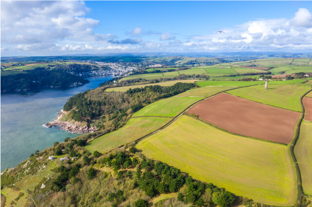 Aerial view of Dartmouth and Kingswear coast with The Daymark in the fields